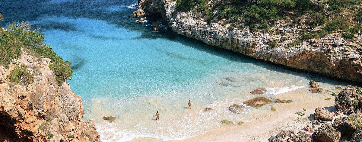 A view of a cove beach and a blue sea in Mallorca