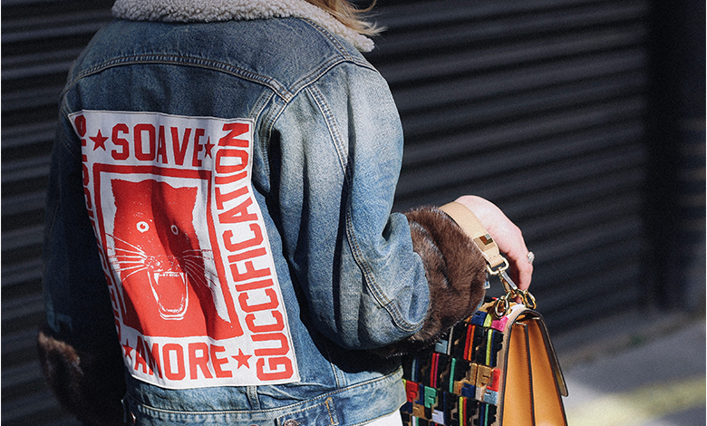 Gucci denim jacket with fur cuffs and patch and Fendi bag