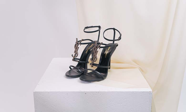 Saint Laurent Cassandra heeled strappy sandal with thin cage straps and bronzed metal YSL monongram