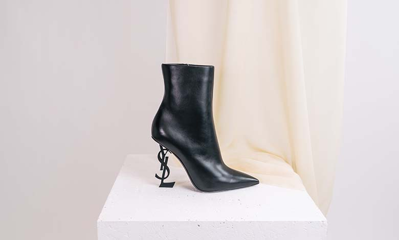 Saint Laurent Opyum heeled black leather boots with monogram heel