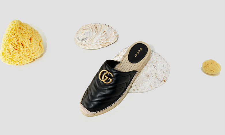 Gucci black leather espadrille mules with gold metal GG logo