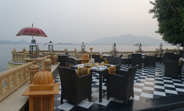 Tables at the Sheesh Mahal restaurant on a balcony overlooking Lake Pichola in Udaipur